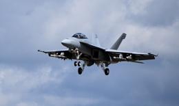 F-18 Hornet against a threatening sky