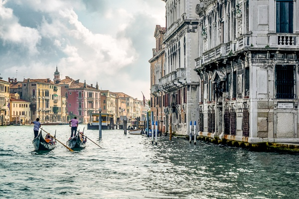 Gondoliers ferrying people in Venice by Phil_Bird