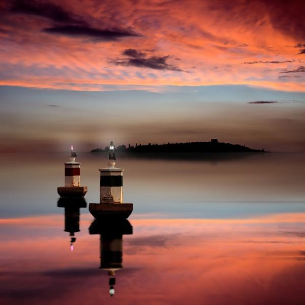 Buoys at sunset by Diggeo