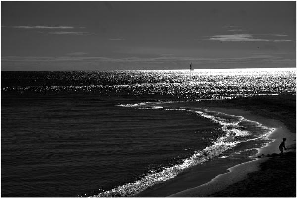 Last boy on the beach by nikon