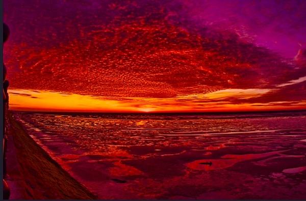 Sunset across the Dee Estuary by phiggy