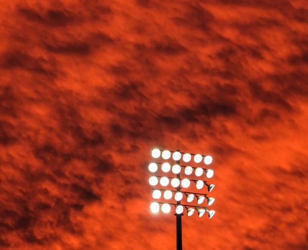 Floodlight and sunset by allan47
