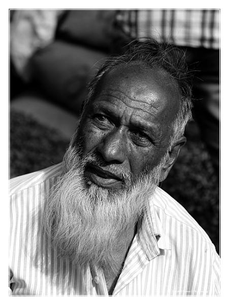 Portrait of a road side vegetable seller by ashokynk