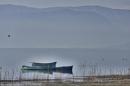 Hazy Glow on Three Boats by nonur
