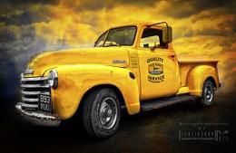 Big yellow Chevvy truck
