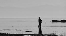 Fisherman's Walk in the Lake on a Gloomy Day