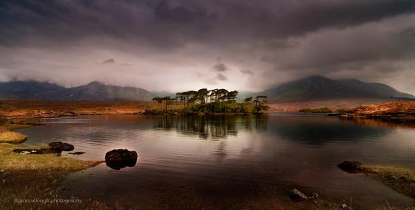 sunset over came lough ,connemara ireland . by rabbit123