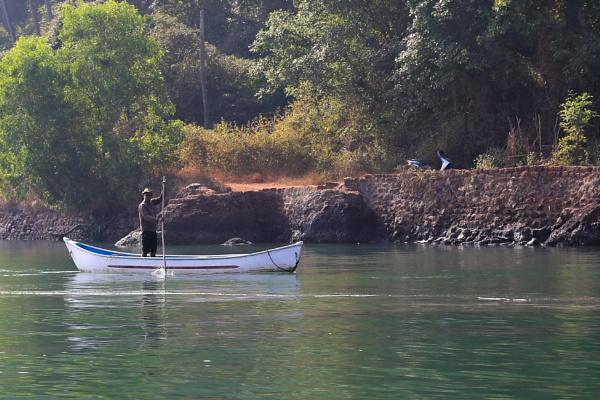 paddling his canoe by brianwakeling