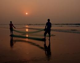 Fishermen with sun & sea.