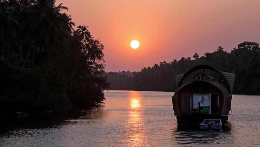 Houseboat cruising down the Chapora River, Goa