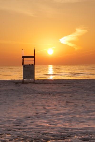 Sunrise icy beach