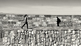 Girl on harbour wall