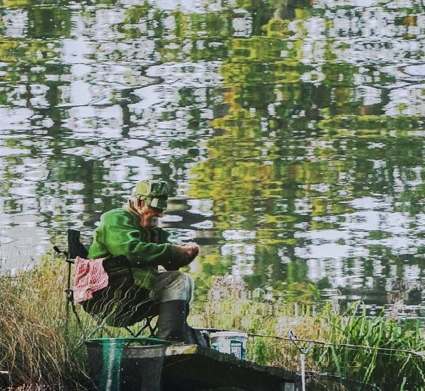 A Reflecting Fisherman by CrustyPics