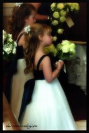 Bridesmaid in soft focus.