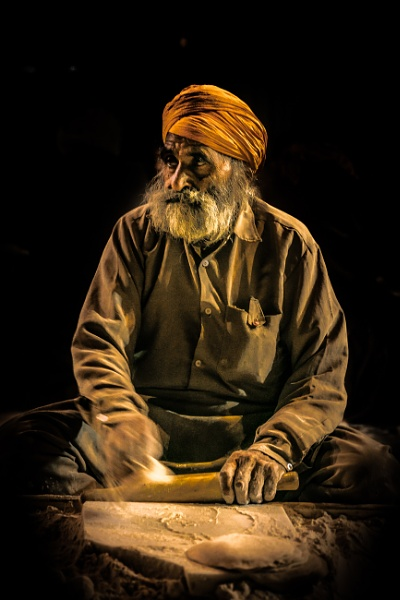 Sikh gentleman making Chapatti at Golden Temple kitchen by bobbyl