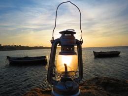 Sunset throug an old Gas lamp