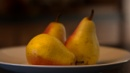 Three Pears on a White plate by taggart