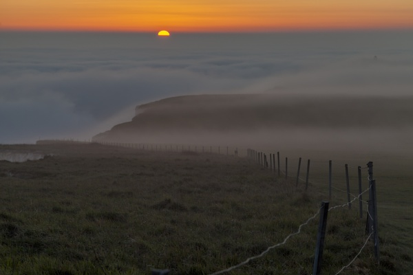 Sunset in the mist by Daveangood