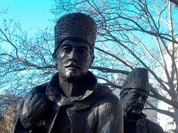Part of the MIGRATION STATUE