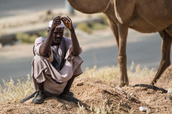 Camel herder taking a break. by WorldInFocus