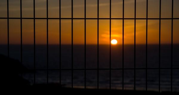 Behind bars by Madoldie
