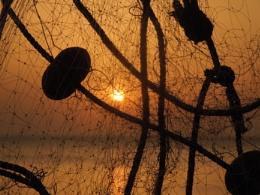 Sunset throug a Fishing net.