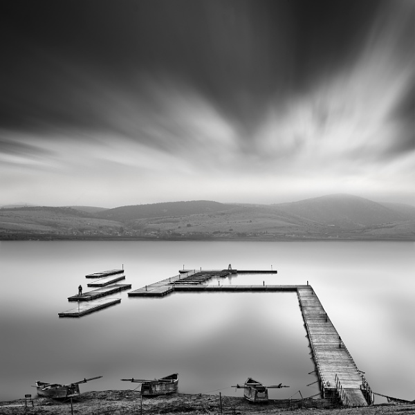 Pier and boats by Diggeo