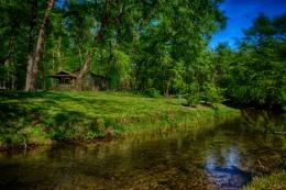 Log Cabin on a Creek