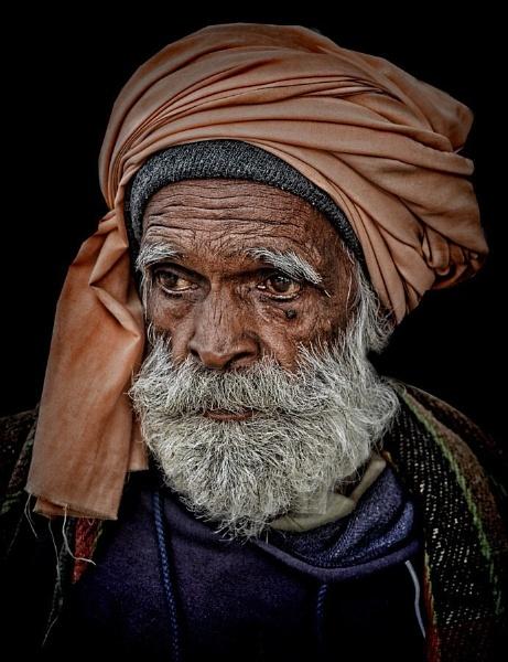 Old Indian pilgrim in Varanasi by sawsengee