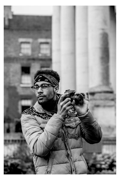 Man with camera by JeffHubbardPhotography