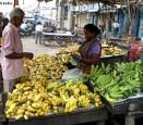 Woman selling bananas by debu