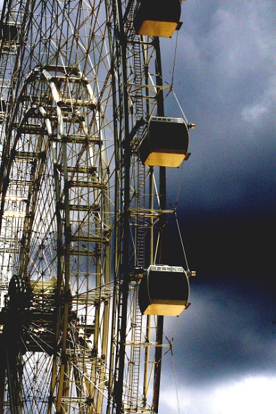 Farris Wheel and Storm Clouds by Nesto