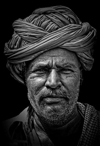 Rajasthani camel herdsman by sawsengee