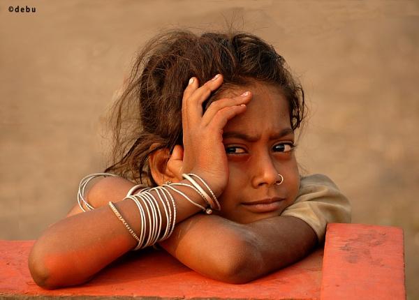 Poor little  girl lost in deep thoughts.......send me to school. by debu