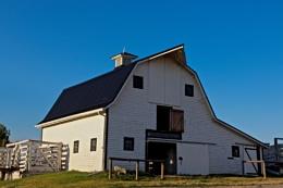 Light on the white barn