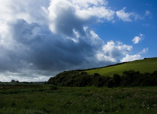 Passing rain clouds by Madoldie