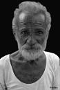 Street portrait of an old man by debu