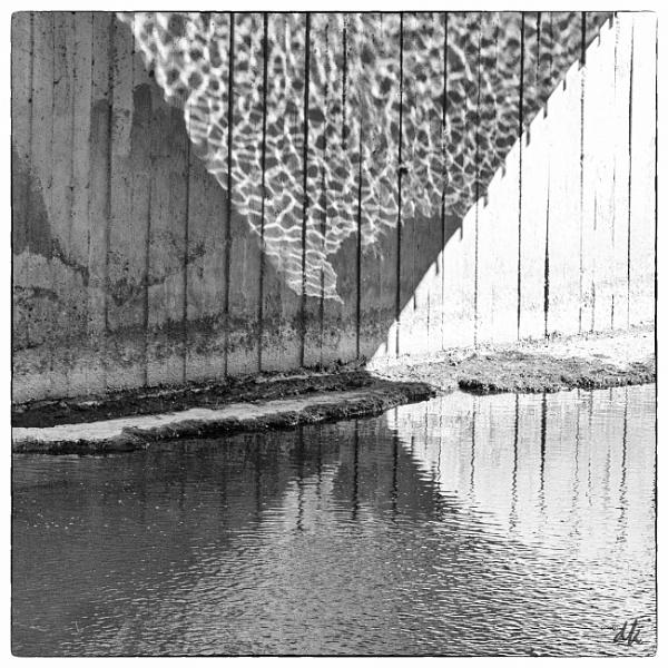 Reflections under a bridge