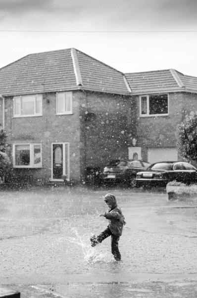 Splashing in the rain by Flymoman
