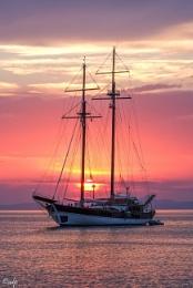 Traditional sailboat at Milina bay.