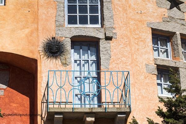 Colourful Detail of Balcony, Railings, Veranda, and Windows on a Grotto-Style Building. Porto Cervo, Costa Smerelda, Sardinia, Italy by JohnI