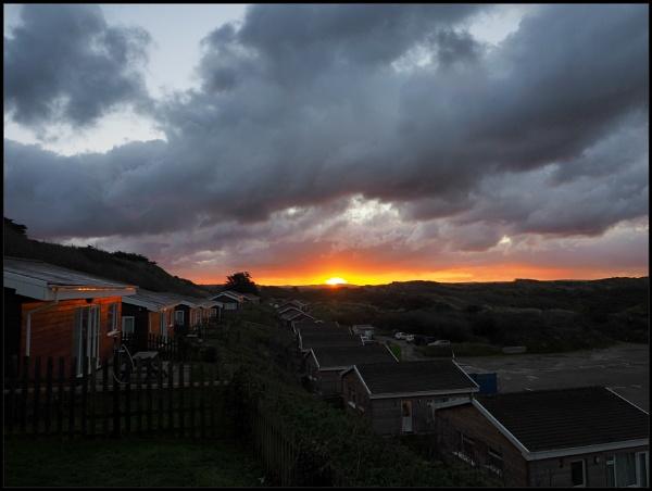 Sun rise,sun set on Devon coast. by brandish