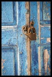 Rusty padlock and pealing shutter