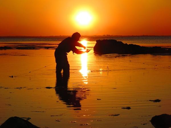 Fishing at sunset by bulbulov