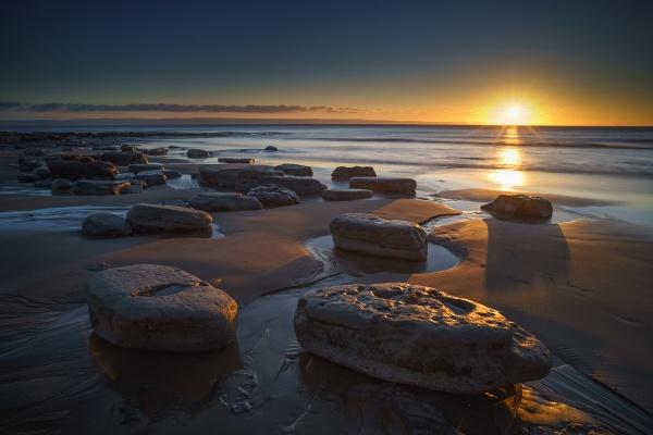 Boulders At Sunset by jarvasm
