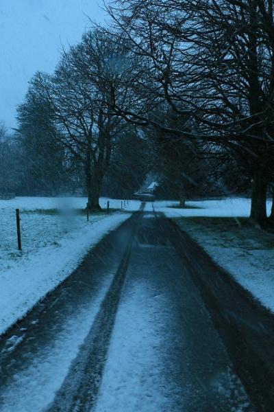 Snowy road by gunner44