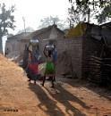 Women walk kilometers to fetch drinking water. by debu