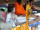 :Naga Sadhu and Devotees by debu