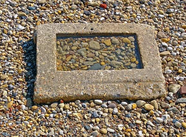 Pebbles , framed by andart