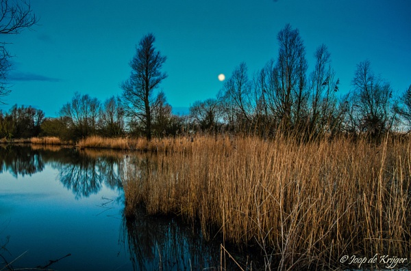 Sunrise with moon by joop_